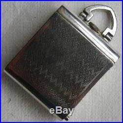 Fine Pocket watch 36 mm. X 30 mm. Aside close load manual nickel chromiun case